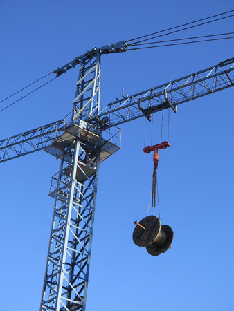 fiberoptic: Cable drum hoisted on crane to prevent theft