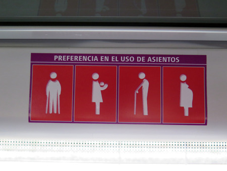 preference: Notice of who should have preference to seats on local train, Alora, Andalucia Stock Photo