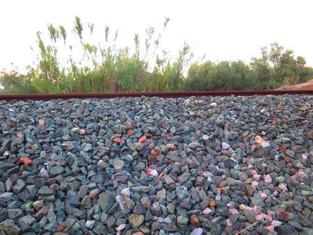 ballast: Close-up of railway ballast on sunny day in Spain