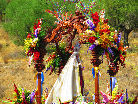 richly: Richly Flower decorated float with Flores, Patron Saint of Alora at local fiesta in Andalucia Stock Photo