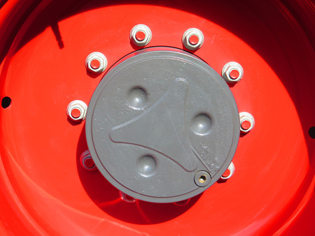 red centre: Closeup of centre of a red tractor wheel