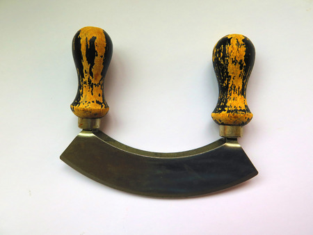 handled: Old fashioned wooden handled steel parsley chopper