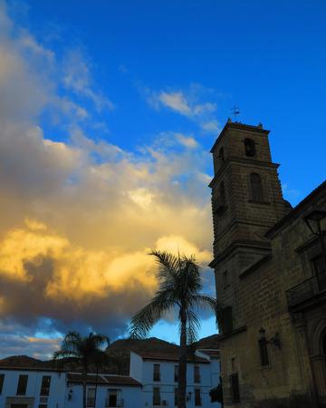 moody sky: Alora parish church tower against moody sky, Andalucia Stock Photo