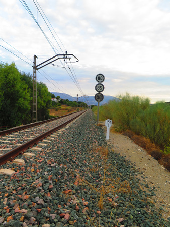 restrictions: Railway Sign showing various speed restrictions near Alora, Andalucia Stock Photo