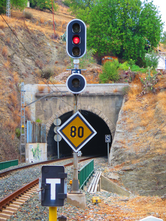 distance marker: Signal lights, speed restriction and distance marker at railway tunnel near Alora, Andalucia Stock Photo