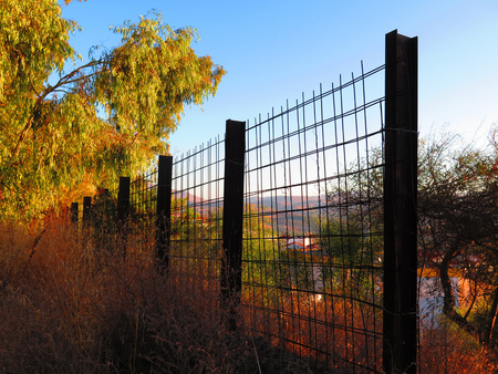 girders: Rural Girder fence in early morning sunshine Stock Photo