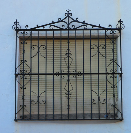 window: Wrought Iron Grill or bars on Window in Alora, Andalucia Stock Photo