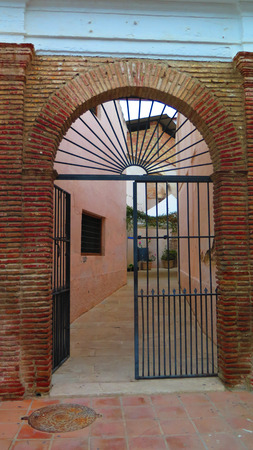 portal: Brick and wrought iron entrance portal to Alora Museum, Andalucia