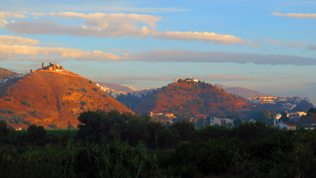 andalucia: Early morning sunshine on the three hills of Alora, Andalucia Stock Photo
