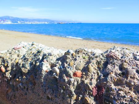 malaga: Concrete seawall on Malaga beach, Andalucia