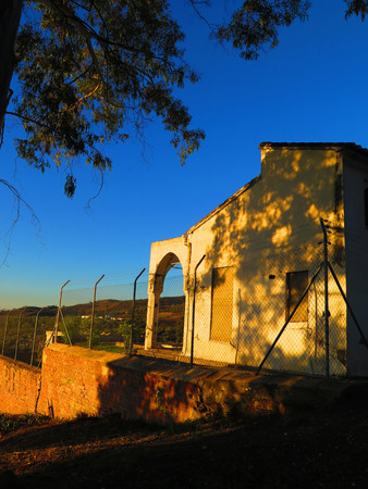 andalucia: Arch on Derelict building behind fence in Alora, Andalucia Stock Photo