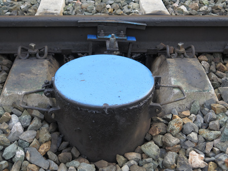 ballast: Blue topped container in ballast on Electric railway line near Alora Andalucia Stock Photo
