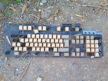 discarded: Broken and Discarded computer keyboard in country lane