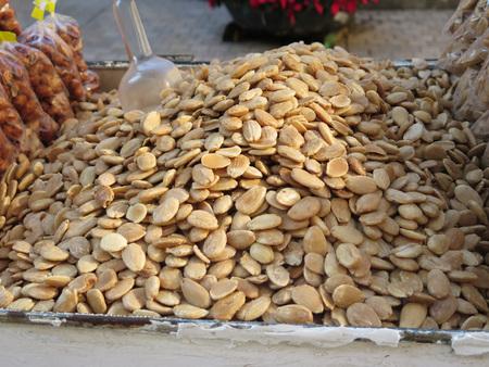 vendor: Street vendor stall selling roasted almonds in Malaga city centre