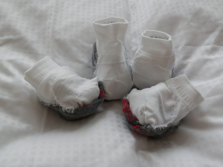 bunched: Two pairs of white sports socks on bed