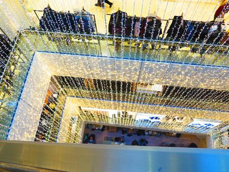 atrium: Long chains of Christmas lights in Department store Atrium, Copenhagen Stock Photo