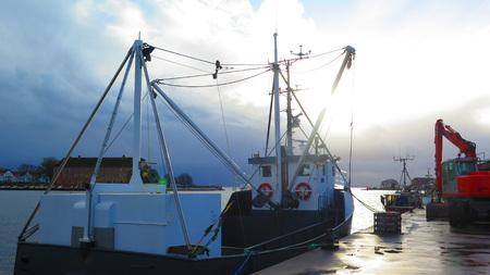 trawler: Fishing Trawler in Sonderburg Harbour on Gray Day Stock Photo