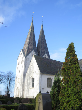 spires: Ornately cladded Twin spires on Broager Church Stock Photo