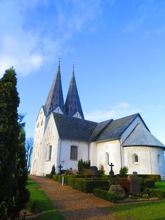 ornately: Ornately cladded Twin spires on Broager Church, Denmark