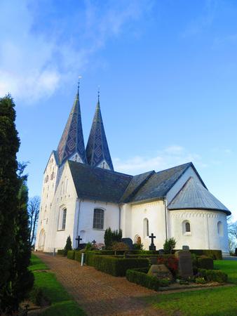 spires: Ornately cladded Twin spires on Broager Church, Denmark