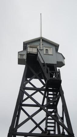 vigilance: Tall wooden coast guard lookout tower in Dragoer Harbour, Denmark