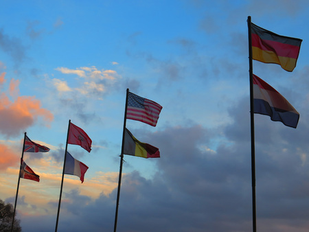 nations: Eight nations flags blowing in the wind near Alora, Andalucia