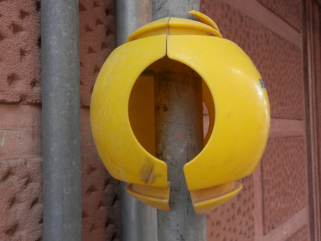 scaffold: Large round Yellow plastic protection on Scaffold Stock Photo