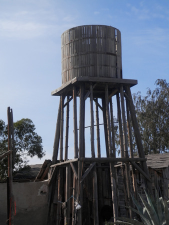Old west abondoned water tower in ghost town Stock Photo
