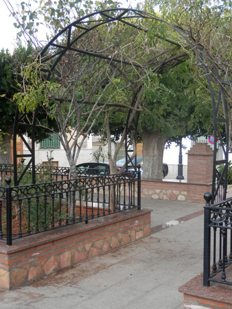 latticework: A small open metal gazebo or pavilion in a garden in Tabernas Village, Andalucia