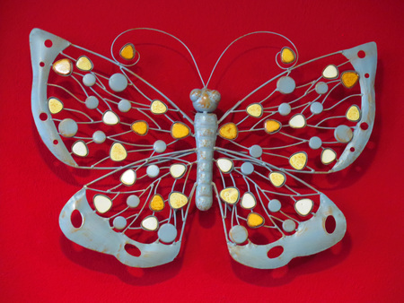 red pink: Close-up of ceramic butterfly on red background Stock Photo