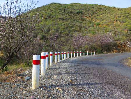 bollards: Curve with White and red road bollards Stock Photo