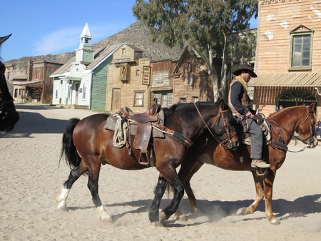 bravo: FORT BRAVO SPAIN - JANUARY 23RD - Two horses and rider on film set near Tabernas Almeria. Fort Bravo Spain January 23rd 2016