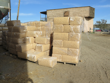 horse stable: Stacks of Plastic wrapped wood shavings for horse stable