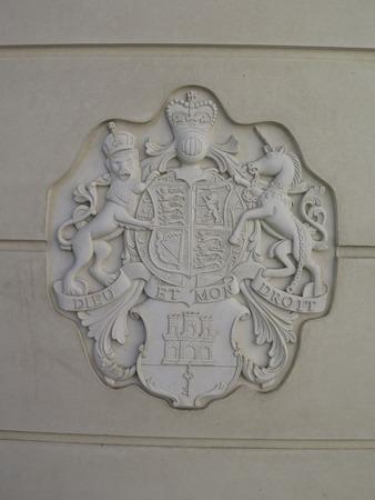 latrine: Public toilet in Gibraltar border crossing sporting royal crest