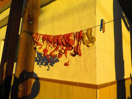 orange peel skin: Orange peel drying in the sun against yellow wall