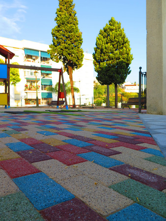 porous brick: Colourful paving stones in childrens playground in Alora, Andalucia
