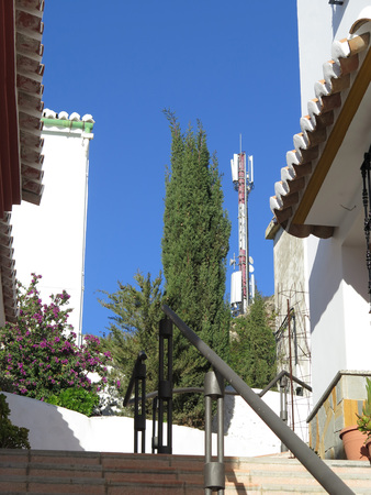Radio communication relay station on sunny day in Alora, Andalucia