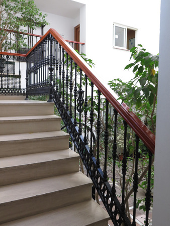 bannister: Ornate railing and steep steps in patio in Fuengirola, Andalucia