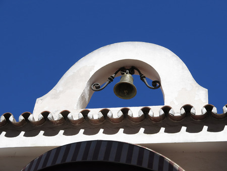 Close-up of belfry and bell in Fuengirola, Andalucia