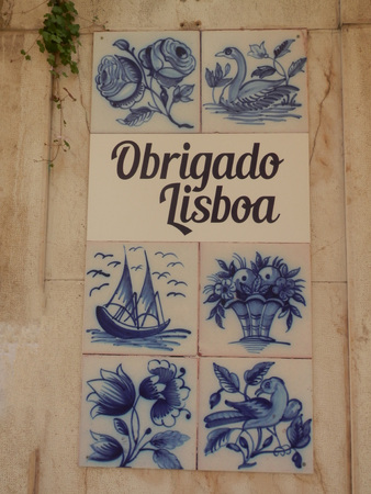 tiled wall: Decorative tiled wall saying thank you in Portugese