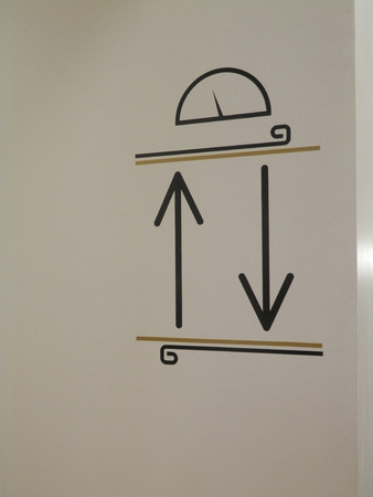 depicting: Graphic sign depicting elevator in Lisbon apartment building