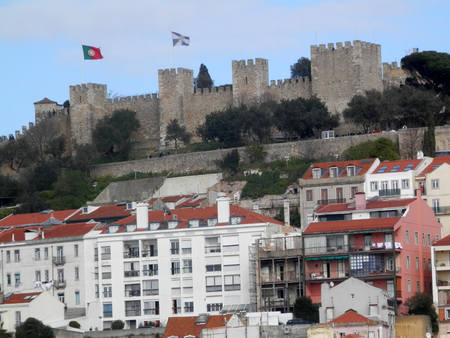 occupying: São Jorge Castle occupying a commanding hilltop overlooking the historic centre of the Portuguese city of Lisbon and Tagus River Editorial