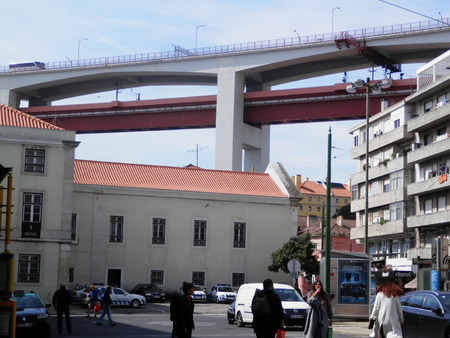 march 17th: Lisbon, Portugal, March 17th 2016.The Bridge of April 25th running high over Lisbon rooftops