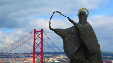 cristo: Statue of woman looking at Cristo Rei in Alameda district of Lisbon, Portugal Stock Photo
