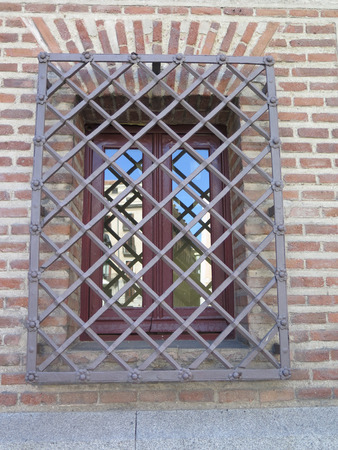 window bars: Wrought Iron Grill or bars on Window in central madrid, spain Stock Photo