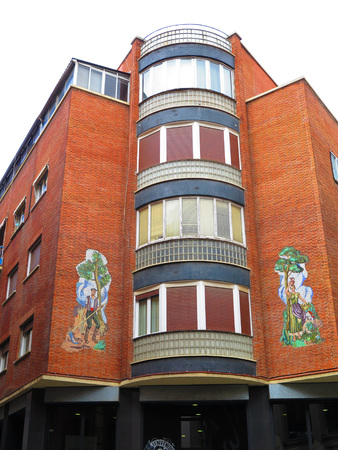 murals: Madrid Corner Building with two large murals Editorial