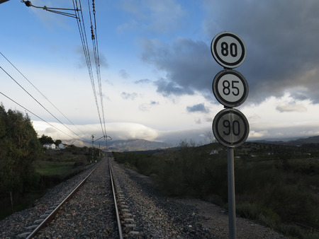 restrictions: Railway Sign showing various speed restrictions near Alora Andalucia Stock Photo