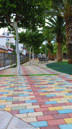 porous brick: Colourful paving stones in Freedom Fighter Park, Alora Editorial
