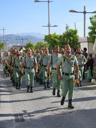 processions: Alora, Spain 25 March 2016: Foreign Legion soldiers arrive to take part in Easter processions.