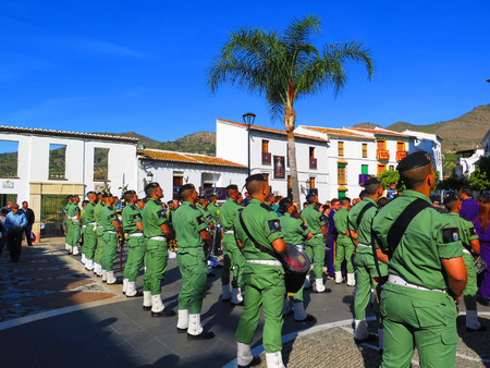 processions: Alora, Spain 25 March 2016: Parachute Regiment soldiers taking part in Easter processions.